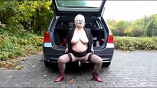 Old woman outdoor nude